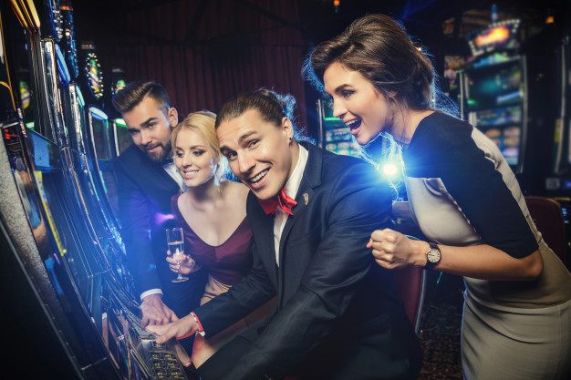 group-friends-playing-slot-machines_144962-7665