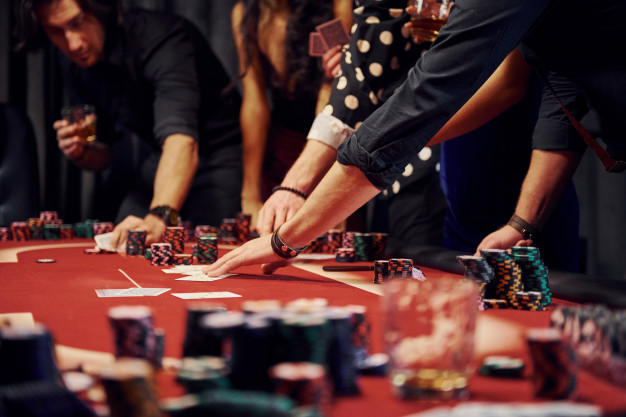 people-elegant-clothes-standing-playing-poker-casino-together_146671-5762