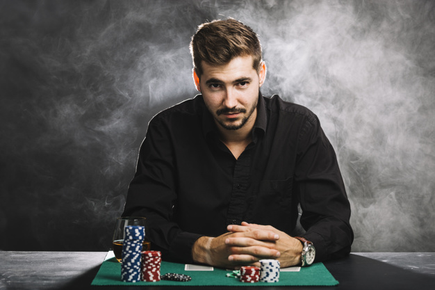 portrait-male-player-with-casino-chips-playing-cards_23-2147937906